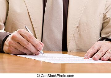 important signature - businessman signing some important...