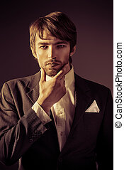 imposing - Portrait of a handsome man in elegant black suit...