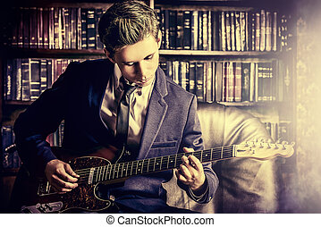 imposing - Handsome young man playing rock-n-roll music on...
