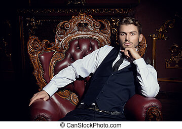 well dressed man - Imposing well dressed man sitting in an ...