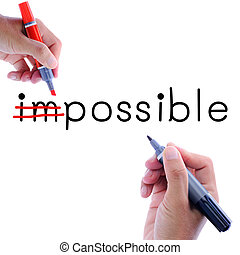 Impossible - Man hand writing possible from impossible....