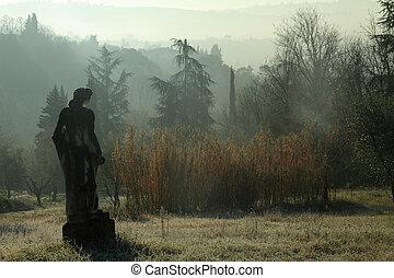 impression with sculpture in italian garden