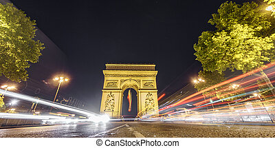 Impressive Arc de Triomphe and car lights at night