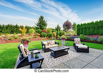 Impressive backyard landscape design with patio area -...