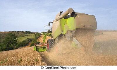 Impressive close up, Following a combine harvester,...