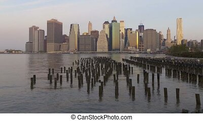 Impressive day to night time lapse panorama view on New York Manhattan downtown seascape modern architecture skyline