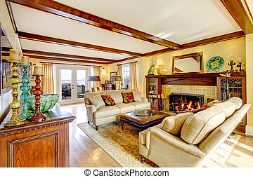 Impressive living room with ceiling beams and fireplace