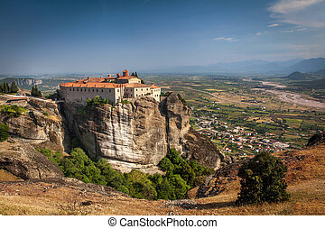 Impressive monastery construction on high hill at Meteora - Greece