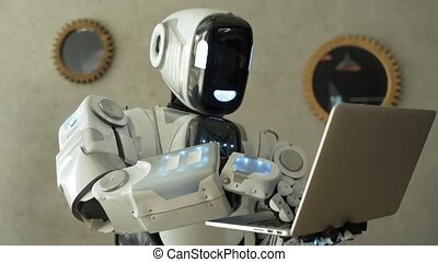 Impressive robot typing on laptop - Innovative technologies....