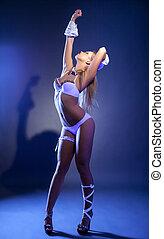 Impressive slim dancer posing in ultraviolet light - Image...