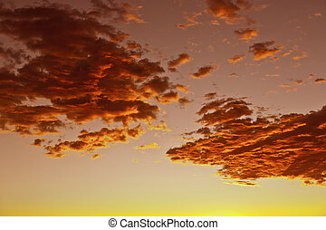 impressive sunset in the desert in Arizona with golden clouds