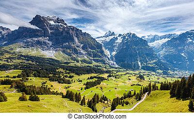 Impressive view of alpine Eiger village. Popular tourist attraction. Location place Swiss alps, Grindelwald valley, Europe.