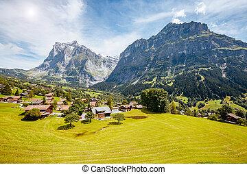 Impressive view of alpine Eiger village. Popular tourist...