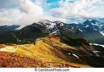 Impressive view of sunlit hills. Location place Grossglockner High Alpine Road.