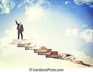 improve myself - happy businessman on books stair