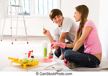 Improving flat - Photo of young couple sitting on floor of...