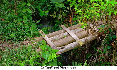 Improvised bamboo Bridge over Irrigation Canal in Bali, with Sound