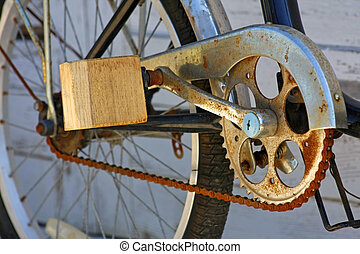 Improvised pedal - wooden pedal of old bike with rusty chain