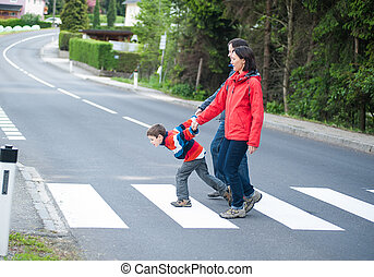 Imptatient Boy with his Family crossing the Road