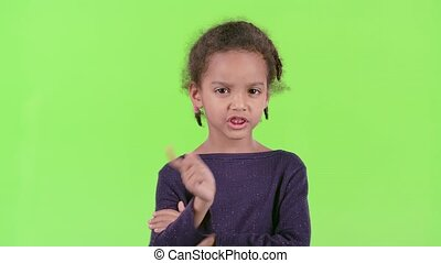 in a bad mood. Green screen - Baby is in a bad mood, she is...