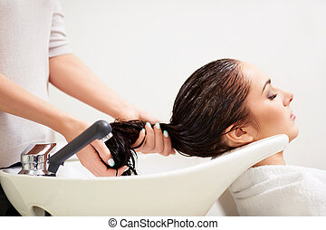 In a beauty salon - Girl washed hair in a beauty salon