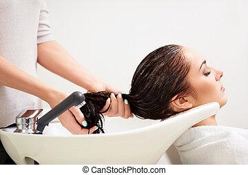 In a beauty salon - Girl washed hair in a beauty salon