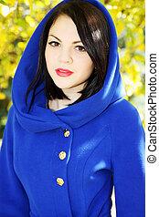 in a blue coat