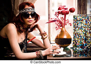 in a cafe - young woman in summer clothes and sunglasses...
