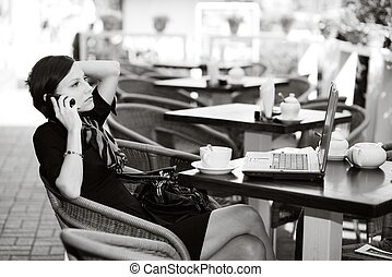 In a caffe - An image of a young woman in a small caffe
