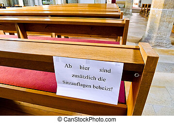 in a church benches are additionally heated in winter.