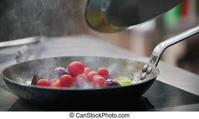 In a frying pan fried onions, add cherry tomatoes, close up