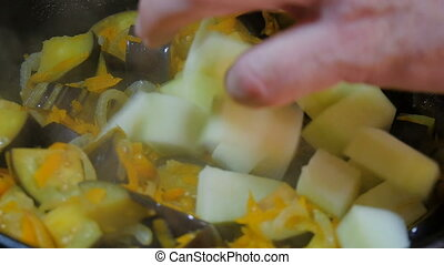 In a hot frying pan cook eggplant, onions, carrots, and add the zucchini.
