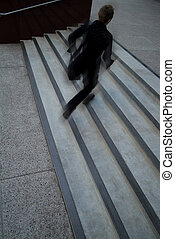 in a hurry - young business person running up stairs