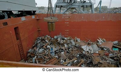 In a large container with metal debris fall iron parts, a...