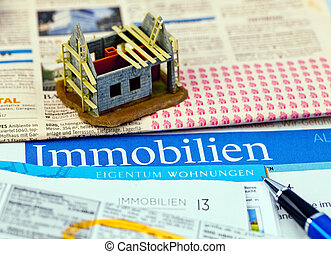 in a newspaper properties are offered for sale. ads for home purchase and housing.