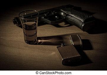 noir desk, with gun schotch and vintage lighter