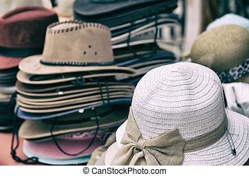 d1073375256 Handmade pretty women hats. classic summer hats hanging in a store ...