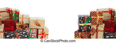 In a panoramic frame, many colorful gift boxes lie on an isolated white background. Christmas atmosphere.