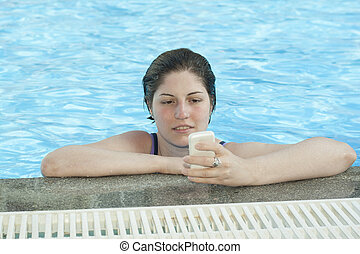 In A Pool wth mobile phone