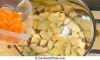 In a pot of potatoes add the carrots and broth