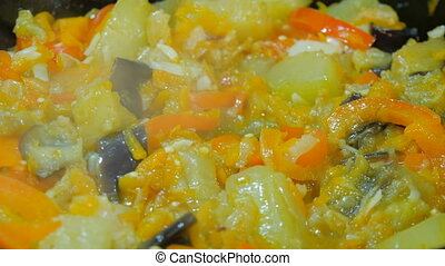 In a saucepan, vegetable stew, closeup