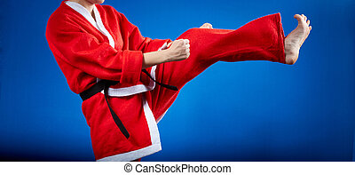 In a suit of Santa Claus the sportswoman is beating kicking