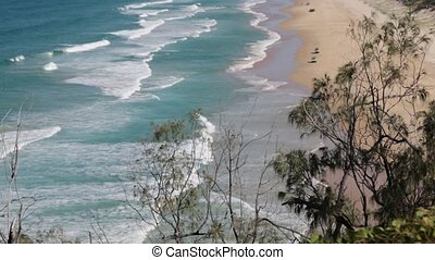 he beach near the rocks in the wave of ocean