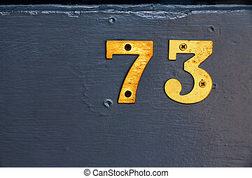 number plate and wood  like background