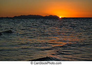 the sunset in the ocean like concept of relax - in australia...