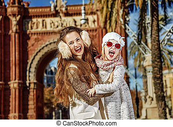 mother and daughter near Arc de Triomf in Barcelona, Spain