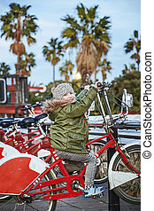 Portrait of happy child in Barcelona, Spain sitting on bicycle