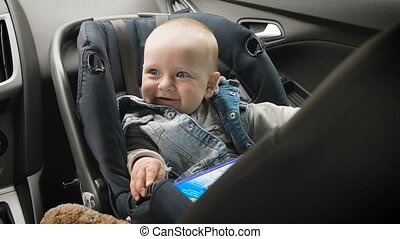 In car safety for children. Little boy sitting in a special car seat