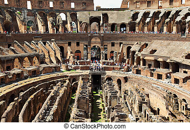 In center of arena in ancient Coliseum in Rome, Italy with occupied people at sunny day
