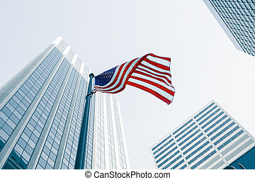 in city - View of American flag on blue building background